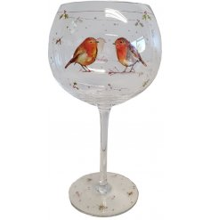 With its sweet sketched bird patterns and details, this elegantly decorated glass will be sure to add a festive winter