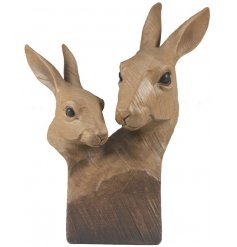 A beautiful natural wooden bust featuring a carved Hare decal