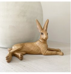 this decorative lounging hare in a natural wooden setting will be sure to place perfectly in any Country Charm home