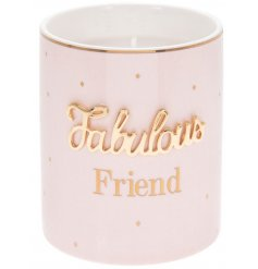 A smooth pink toned candle pot featuring a golden scripted text and delightfully scented wax centre