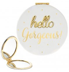 A sleek white toned folding compact mirror featuring a fabulous golden script text and dot decal