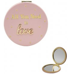 A pretty pink toned folding compact mirror featuring a fabulous golden script text and dot decal
