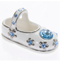 A diamante encrusted baby bootie in blue. A lovely gift for a new baby or Christening.