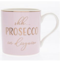 A pink toned mug featuring a gold scripted text and added rim decal
