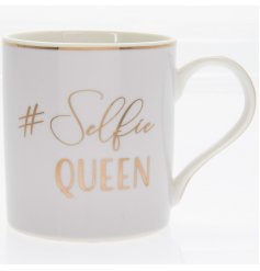 "A charming smooth White toned mug set with a scripted ""#Selfie Queen"" text and added gold decal"