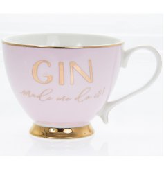 A Chic and Stylish baby pink toned mug with an added gold rim, scripted text and footed base