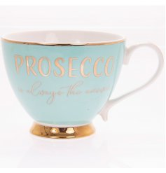 A Chic and Stylish baby blue toned mug with an added gold rim, scripted text and footed base