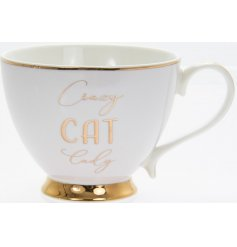 Sip your tea in style with this fabulous white toned footed mug, complete with an added golden script text and rim deca