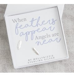 A sleek white gift box filled with a scripted text card and simplistic sterling silver feather earrings