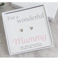 A sleek white gift box filled with a scripted text card and simplistic sterling silver heart earrings