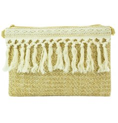A large Woven Raffia clutch bag featuring a macrame tassel trimming and secure zip closure