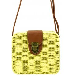A beautiful little woven basket bag with an added rustic buckle feature and faux leather accents