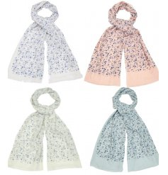 A delightful mix of floral inspired fabric scarves each set with its own tone and subtle sprinkle of glitter