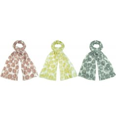 A beautiful mix of soft fabric scarves, each decorated with its own colourful geometric inspired decal