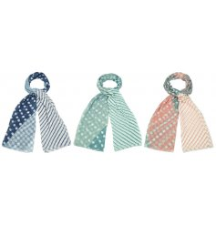 A mix of soft fabric scarves in an assortment of coloured patterns