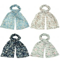 A beautiful mix of coloured scarves each decorated with a floral print and added glitter sparkle