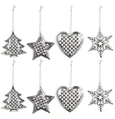 A festive mix of hanging metal tree decorations, assorted by their patterns and shapes