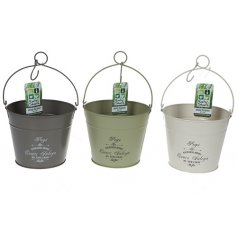 An assortment of vintage metal peg buckets in green tones