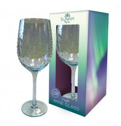 A gorgeous, long stemmed Wine Glass featuring a charming blue tint and an added dewdrop decal