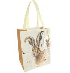 A beautiful large gift bag with fabric handles and a country living hare design by Yorkshire based artist Bree Merryn.