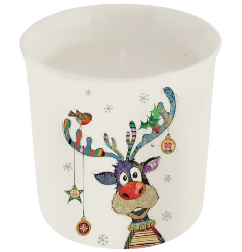 A Christmas candle with a colourful and quirky patchwork Reindeer illustration