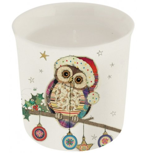 A colourful and quirky Christmas candle featuring an intricate patchwork owl illustration, complete with baubles.