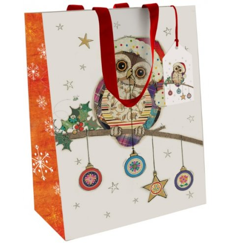 A fine quality Christmas gift bag with a colourful and quirky patchwork owl illustration.