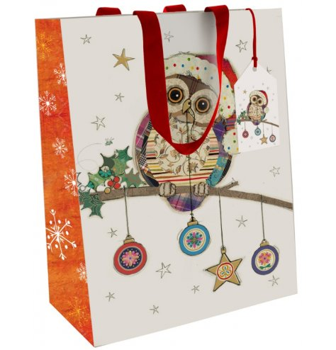 A colourful and quirky illustrated Christmas gift bag with a patchwork owl design.