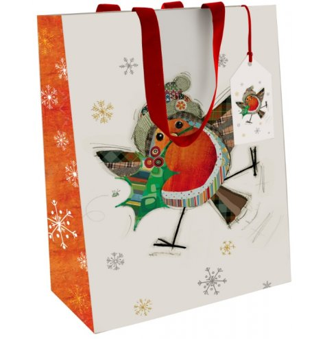 A colourful and quirky Christmas gift bag featuring a patchwork robin illustration with a scattering of snowflakes.