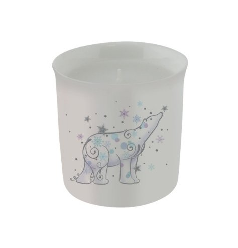 An elegant candle decorated with a magical polar bear illustration and sparkling stars and snowflakes.