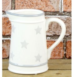 A simple cream toned ceramic jug with an added grey star and trim decal