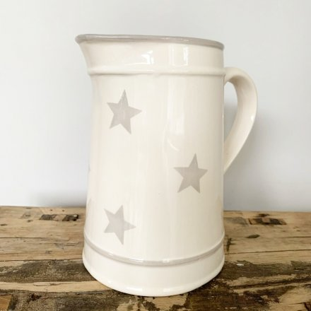 A charming ceramic jug featuring a grey star decal and added trimmings