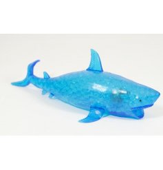 A super squishy blue shark filled with foamy beads
