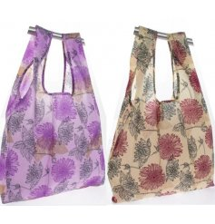 an assortment of purple and orange toned fabric shopping bags, beautifully decorated with a floral decal