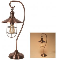 A chic themed metal lamp featuring a warm glowing LED bulb and bronzed decal