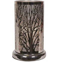 A unique and stylish glass lamp with a bold branch design pattern. A luxury living interiors item for the home.