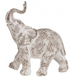 A decorative resin Elephant ornament with an etched pattern and a shabby chic finish.