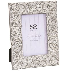 A beautifully shabby chic inspired picture frame with an added embossed floral decal and white wash tone