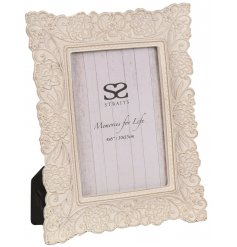 A beautiful picture frame set with a white washed tone and embossed lace decal