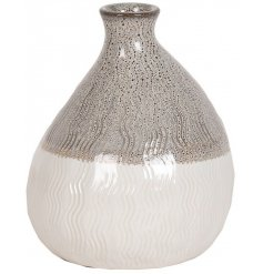 An effortlessly chic vase for the home with a wave pattern and rich gloss glaze.