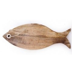 A natural wooden chopping board in a fish form