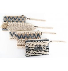 An assortment of 4 fabric clutch bags, each set with a cream and blue toned tassel decal