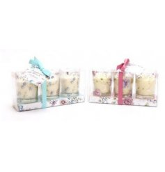 A gorgeous mix of floral themed glass candle pot sets, each filled with sweetly scented wax centres