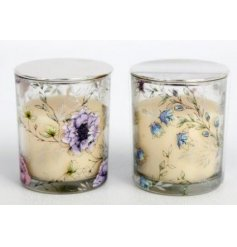 A mix of glass candle pots, each featuring a delightful floral themed decal