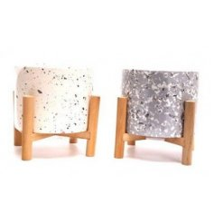 A mix of 2 round candle set with a terrazzo inspired decal and wooden stands