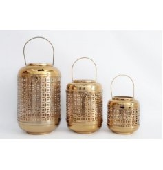A beautifully themed set of assorted sized lanterns, each covered with a shiny gold decal