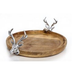 A gorgeously simple natural wooden cake stand, perfectly decorated with silver stag handles