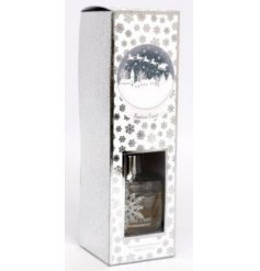 A sweetly scented reed diffuser, beautifully packaged within a Snowflake scattered display box