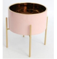 Bring a pretty pink touch to any home decor or garden display with this chic smooth ceramic planter