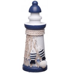 An ornamental Light House decoration perfectly decorated with a Nautical inspired colour scheme